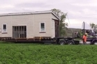 The tracks might be gone, but a 112-year-old train station building has returned home. Source: ODT