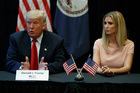 Ivanka Trump listens at right as her father, Republican presidential candidate Donald Trump, speaks during a roundtable discussion. Photo / AP