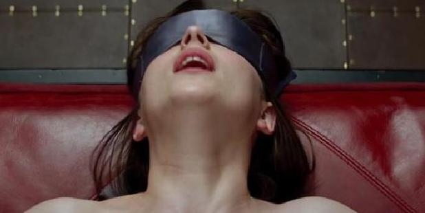 Loading Dakota Johnson as Anastasia Steele in the first Fifty Shades of Grey film.