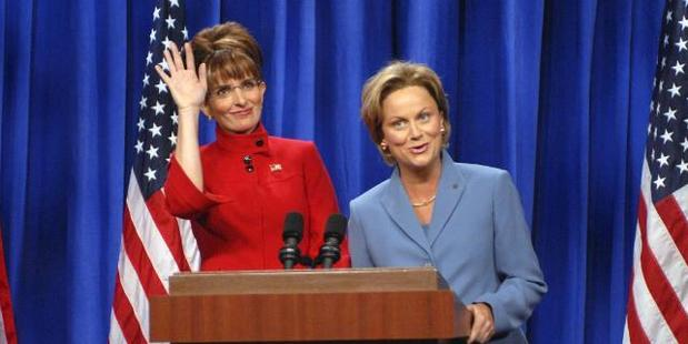 In 2008, Sarah Palin may have hated the impression Tina Fey (with Amy Poehler as Hillary Clinton) did of her but she still did a cameo on the show. Photo / AP