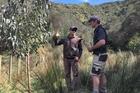 Kevin Cash (left) and Brad Bielski discuss the eucalyptus plantings.