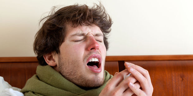 Pressing your tongue against the roof of your mouth should stop your sneeze - without anyone even noticing. Photo / 123RF