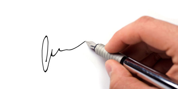 Psychologists have discovered that a person's signature can reveal a surprising amount about their personality. Photo / 123RF.