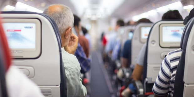 According to new research, men who have less experience flying and describe themselves as being selfish make the most irksome plane passengers. Photo / 123RF