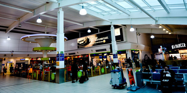 There are few benches that passengers can use for rest at London Luton Airport but there are at least 24-hour dining options. Photo / 123RF