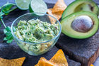 This tip promises to keep your guacamole fresh and green for around 24 hours. Photo / 123RF