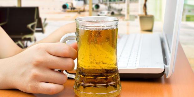 Twenty per cent of travellers have their first drink before 9am. Photo / 123RF