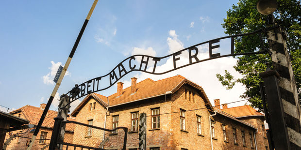 The infamous main gate of Auschwitz, where 1.1 million people died during the Holocaust. Photo / 123RF