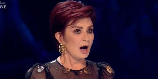 Loading Sharon Osbourne forgets her own act's name live on TV in the reality tv show X Factor.