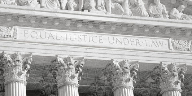 The societal ideal that supposedly influences the American legal system is engraved on the front of the US Supreme Court building. Photo / 123RF