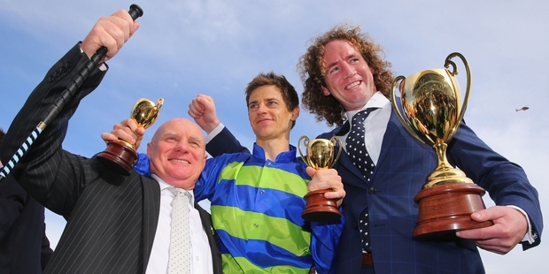 Owner Colin McKenna, jockey Nick Hall and trainer Ciaron Maher celebrate the Cup victory. Photo / Getty Images