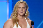 Amy Schumer had around 200 people walk out of her Florida show following an anti-Trump rant. Photo/AP