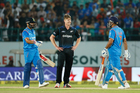 New Zealand's James Neesham reacts after India's captain Mahendra Singh Dhoni, right, hit a six. Photo / AP