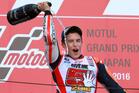 Spain's Marc Marquez pours champagne after winning the MotoGP Japan. Photo / AP