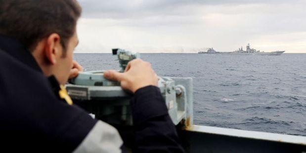 A Royal Navy lookout onboard HMS Richmond, observing Russian aircraft carrier Admiral Kuznetsov. Photo / AP
