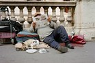 Beggars bring props such pets and bags to attract public sympathy. File photo / Getty Images
