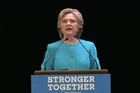 Clinton spoke to supporters in Seattle Friday calling for a 'unifying vision of America' at the end of a negative campaign against Donald Trump.