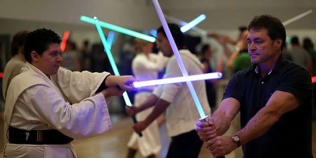 People practicing combat moves with lightsabers during a Golden Gate Knights class in saber choreography on February 24, 2013. Photo / Getty