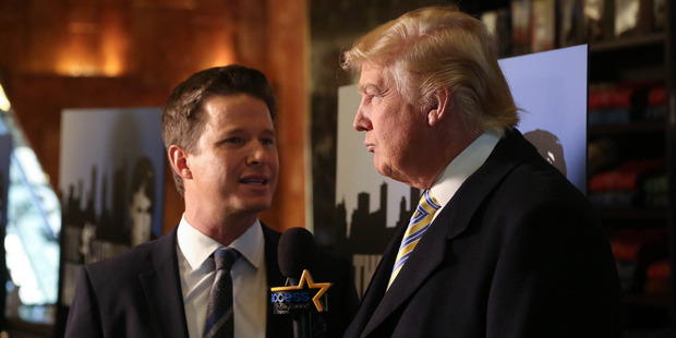 Donald Trump (R) is interviewed by Billy Bush of Access Hollywood at Celebrity Apprentice Red Carpet Event at Trump Tower on January 20, 2015 in New York City. Photo / Getty