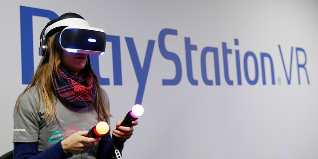 A gamer plays a game with the virtual reality head-mounted display 'Playstation VR' during the 'Paris Games week'. Photo / Getty
