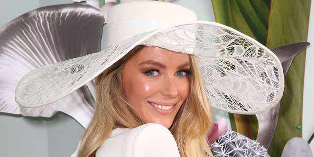 Jennifer Hawkins wearing Alex Perry and millinery by Ann Shoebridge poses at the Myer Marquee on Derby Day at Flemington Racecourse. Photo /Getty