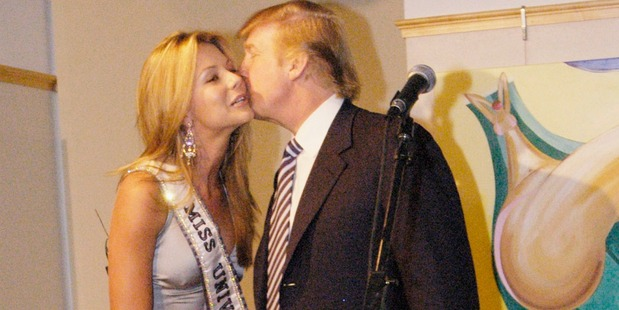 Donald Trump kisses Miss Universe, Jennifer Hawkins at a cocktail party hosted by the Hon. Ken Allen, Consul General of Australia, in celebration of her crowning. Photo / Getty