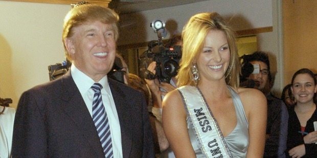Miss Universe, Jennifer Hawkins and Donald Trump pose for photographers at a cocktail party hosted by the Hon. Ken Allen, Consul General of Australia. Photo / Getty
