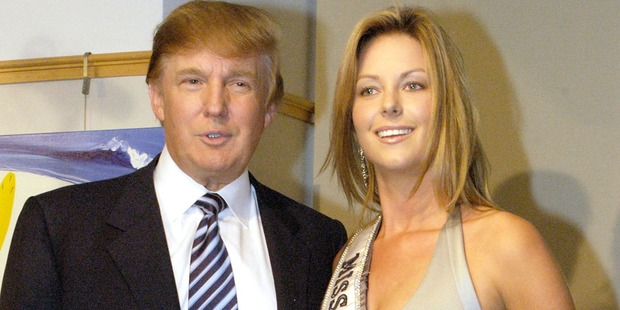 Donald Trump and Miss Universe Jennifer Hawkins pose for photographers at a cocktail party celebrating her crowning on July 28, 2004 in New York City. Photo / Getty
