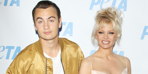Son, Brandon Thomas Lee and Pamela Anderson attend the Los Angeles launch event for Prince's PETA song held at PETA on June 7, 2016 in Los Angeles, California. Photo / Getty