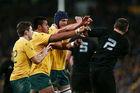 Allan Ala'alatoa and Dean Mumm of Australia shove Dane Coles of the All Blacks. Photo / Getty