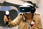 A visitor plays a game with the virtual reality head-mounted display 'Playstation VR' during the second press day of the Paris Motor Show on September 30, 2016. Photo / Getty