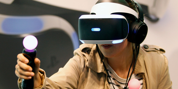 Loading A visitor plays a game with the virtual reality head-mounted display 'Playstation VR' during the second press day of the Paris Motor Show on September 30, 2016. Photo / Getty