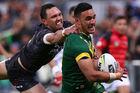 Valentine Holmes of Australia evades Jordan Rapana to score. Photo / Getty