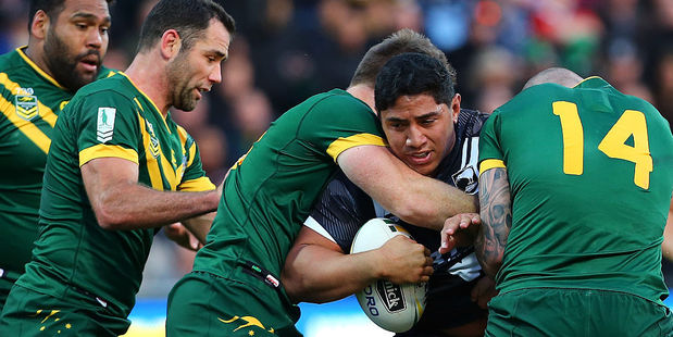 Jason Taumalolo of New Zealand gets surrounded by Kangaroos defenders in the first test. Photo / Getty