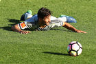 Phoenix midfielder Vince Lia attempts an innovtative new football strategy against Perth. Photo / Getty