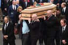 Former Munster players, from left, Peter Clohessy, Keith Wood, John Hayes and Munster captain Peter O'Mahony carry the coffin of Munster Rugby head coach Anthony Foley. Photo / Getty