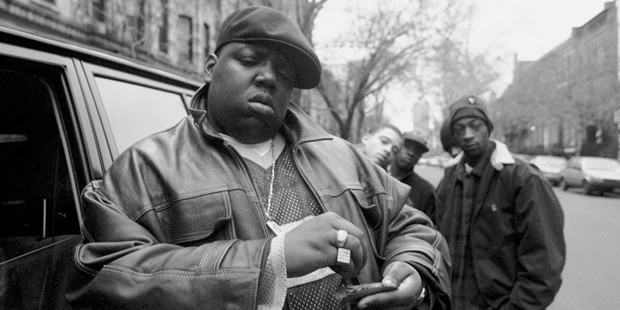 Rapper Notorious B.I.G., aka Biggie Smalls, aka Chris Wallace rolls a cigar outside his mother's house in Brooklyn. Photo / Getty
