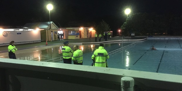 The man refused to leave the pool, standing in the middle and pulling martial arts poses instead. Photo/ Jeremy Batten