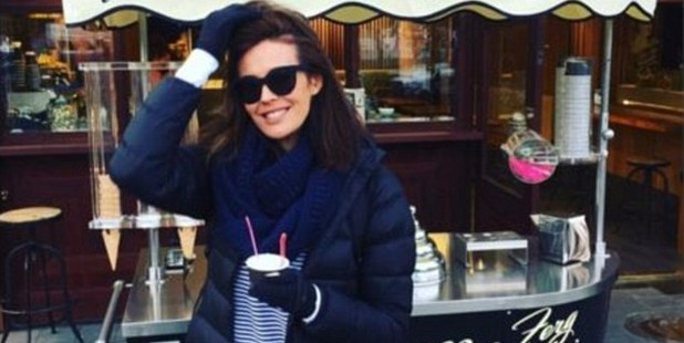 Megan Gale sahes a rugged-up snap of herself enjoying a scoop on holiday.