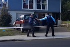 Police at the scene of a stabbing in West Auckland on Saturday.