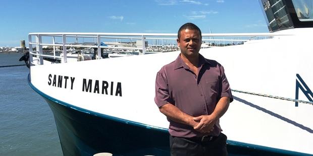 Roger Rawlinson of RMD Fisheries next to trawler Santy Maria. Photo/David Porter