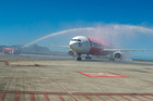 Air AsiaX's inaugural flight lands at Sir Seewoosagur Ramgoolam International Airport in Mauritius. Photo / Supplied