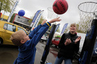 Seven-year-old Xavier Booth tries for a goal, watched by netball legend Irene van Dyk. PHOTO/ BEVAN CONLEY