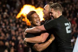 New Zealand's Julian Savea, Israel Dagg and Tawera Kerr-Barlow celebrate a try. Photo / Photosport