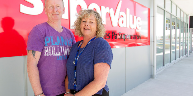 Julie and Tony Bruce in front of the new SuperValue Pyes Pa. Photo/Ruth Keber