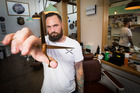 Brendan Blake, aka Bundy the Barber,  is taking a run at the Guinness World Record for the most haircuts given in eight hours. Photo / Jason Oxenham