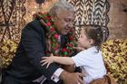 Fiji Prime Minister Frank Bainimarama is presented with a salu salu by Maraia Kauyaki at Bula Kindergarten in Mangere today.  Photo / Greg Bowker