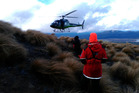 The Taupo Greenlea Rescue Helicopter assists in the rescue of students who were stuck on a ridge on Mt Tongariro.