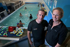 MAKE A SPLASH: Liz van Welie Swim School owners Greg Cummings and Liz van Welie are selling their swim school pool on Trade Me with a $1 reserve. Photo / John Borren