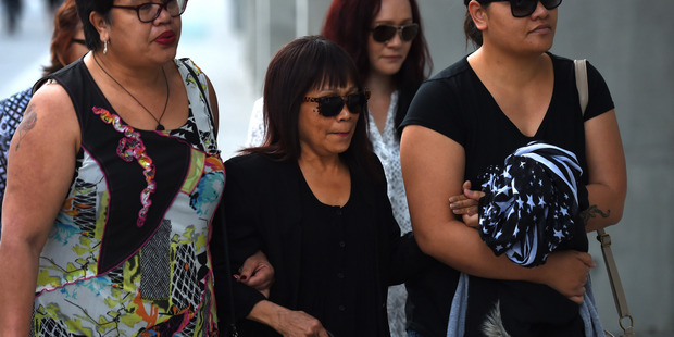 Merzabeth Tagpuno (centre), the mother of New Zealand woman Warriena Wright, arrives at the Supreme Court in Brisbane. Photo / AAP